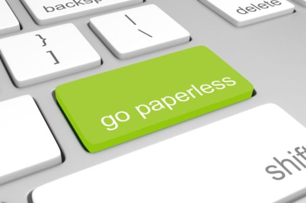"Keyboard with the words ""go paperless"" on a green Enter key"